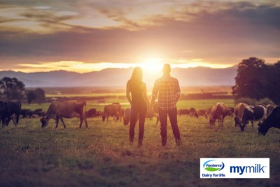 Couple with an sunset in a field, photographed as commercial shoot for Fonterra and MyMilk. Chch commercial photographer.