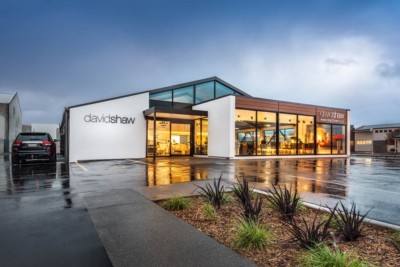 professional exterior commercial architectural photography. David Shaw building photographed at dusk with a reflection.