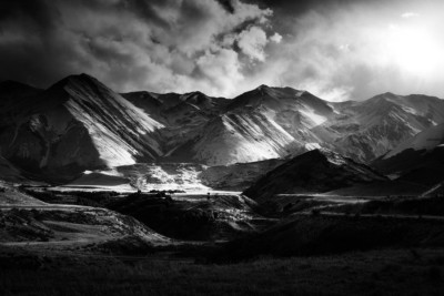 Dramatic landscape photo of mountains with sunlight bringing out 3D form