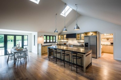 Award winning kitchen photography of a farm house with a high ceiling and classy kitchen.