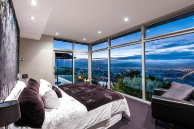 Modern bedroom architecture design with city view, photographed at night